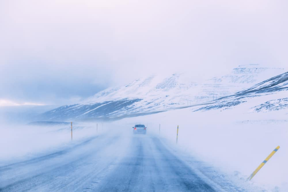 when driving in Iceland, make sure to heed wind and weather warnings so the road isn't icey!