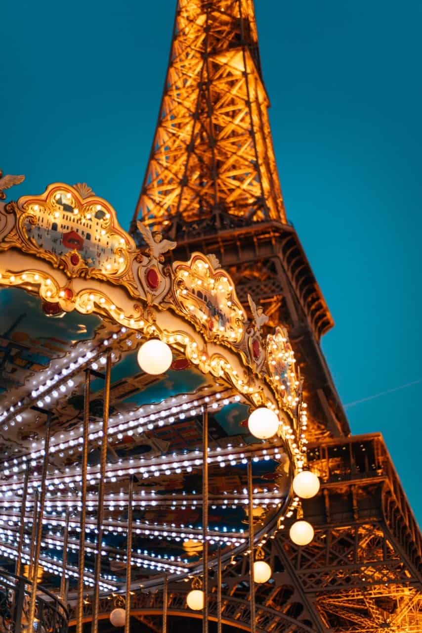 Paris photography of Eiffel tower and carousel during your paris itinerary