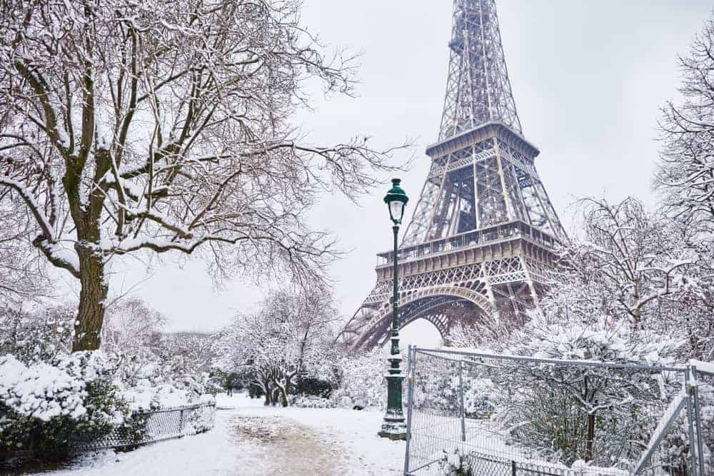 Eiffel tower covered in snow during winter in Paris