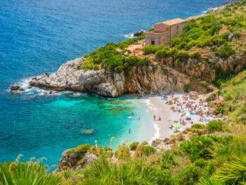Beautiful Sicily Beach Riserva Naturale Dello Zingaro with people on it
