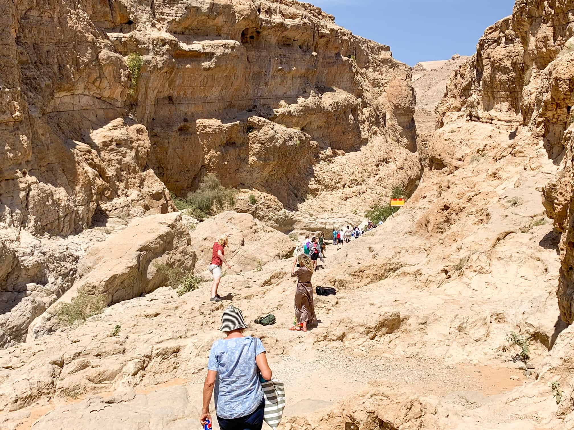People hiking into Wadi Bani Khalid