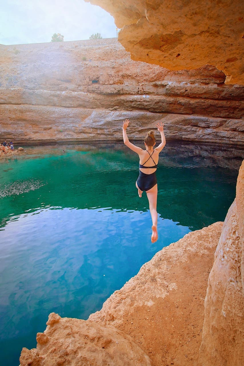Jumping off the cliffs around Bimmah Sinkhole in Oman