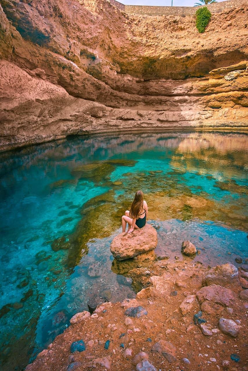 Swimming at Bimmah Sinkhole in Oman