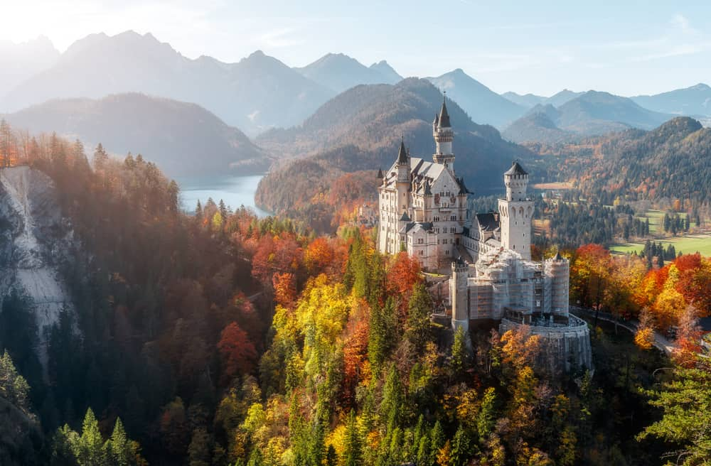 Arguably one of the most beautiful castles in Germany, the view of Neuschwanstein Castle surrounded by trees and mountains is stunning