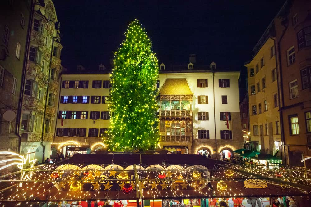 A magnificent tree in the town of Innsbruck, one of the charming Christmas markets in Austria