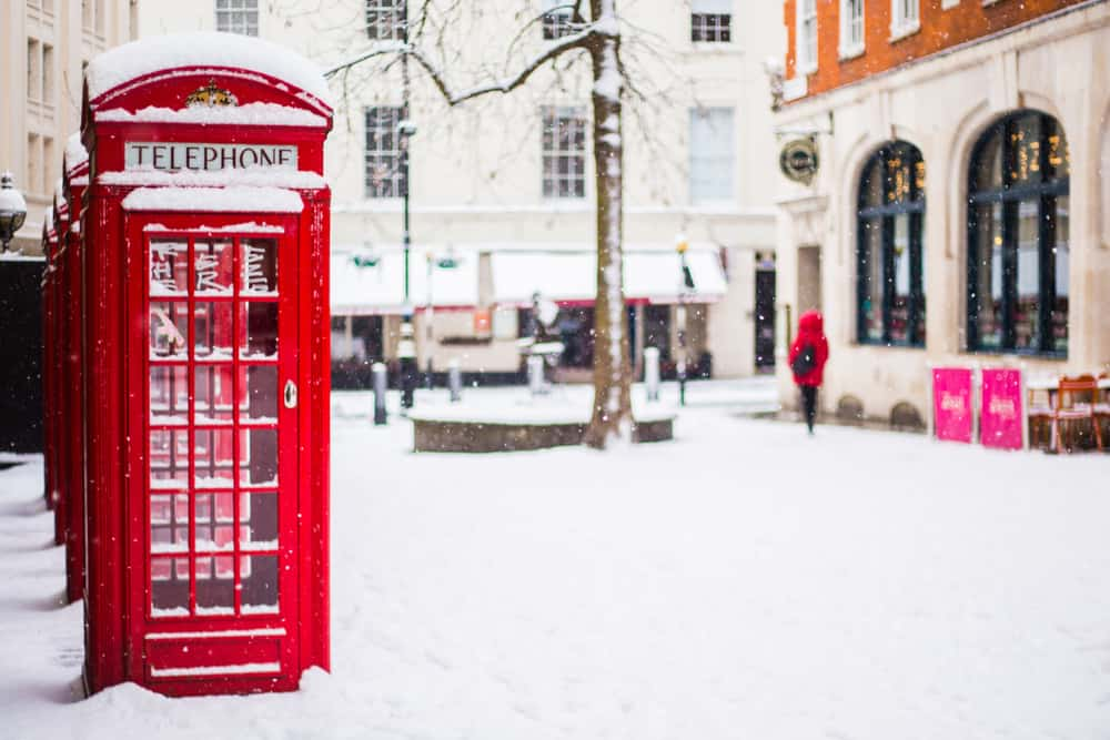 London in winter, a phone box in Covent Gardens covered in snow