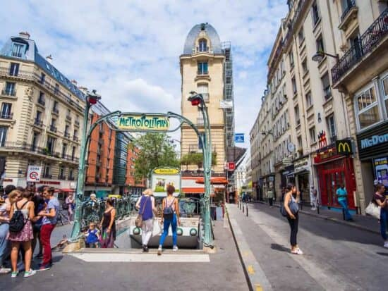 there are many stairs leading to Paris metro stations