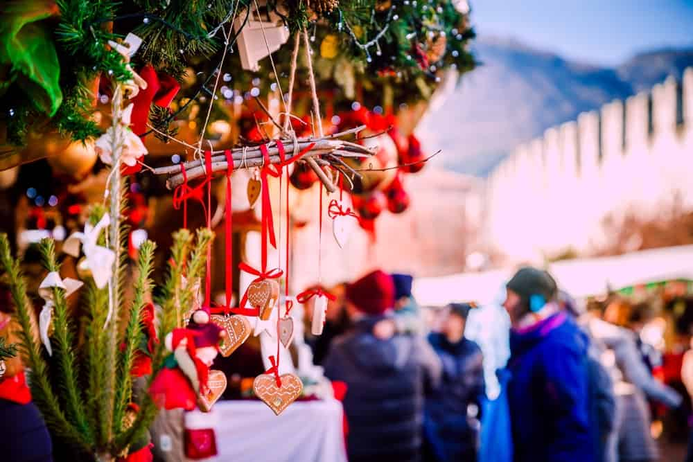 Traditional Kiosks and Shoppers in the Vipiteno Christmas Market