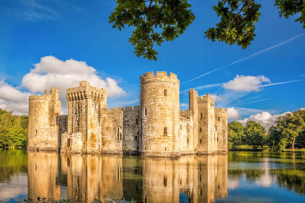 A view of Bodiam Castle from a lake as one of the prettiest Castles near london