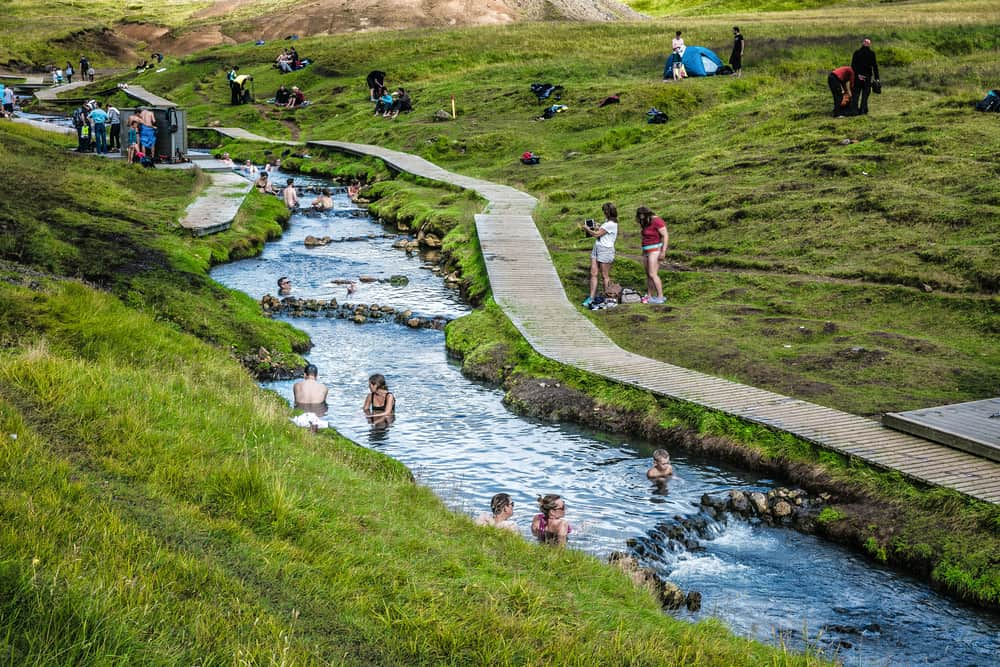people bathing in Reykjadalur Hot Springs in South Iceland