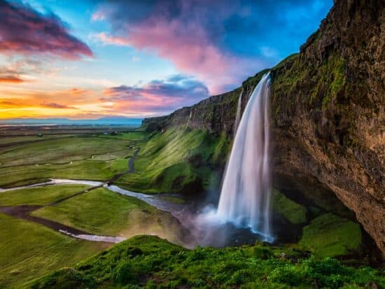 summer at Seljalandsfoss waterfall in South Iceland
