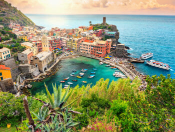 Pretty sunset over a cinque terre village you will see on your Italy itinerary