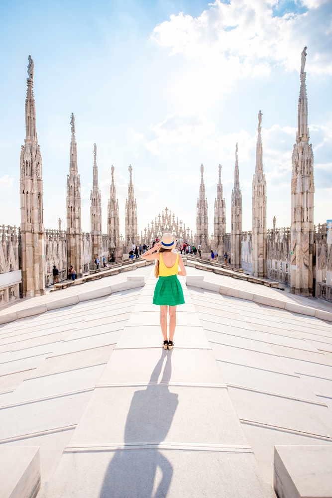woman standing on rooftop of Milan cathedral