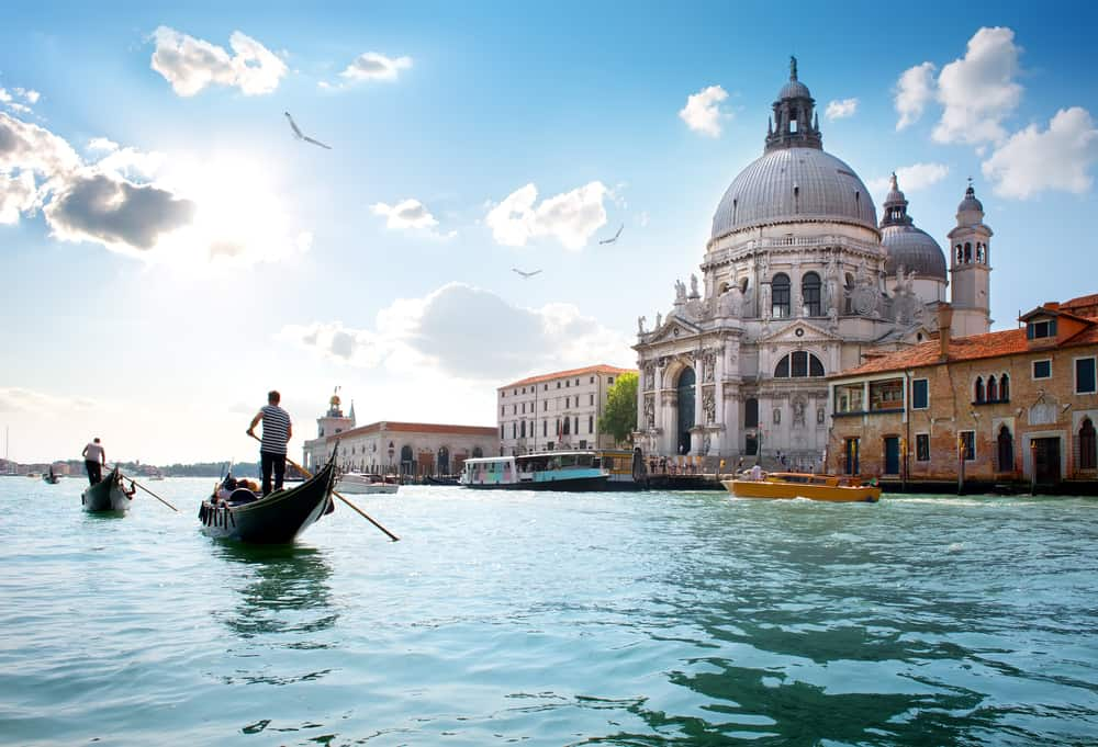gondola boat in venice with church in the background