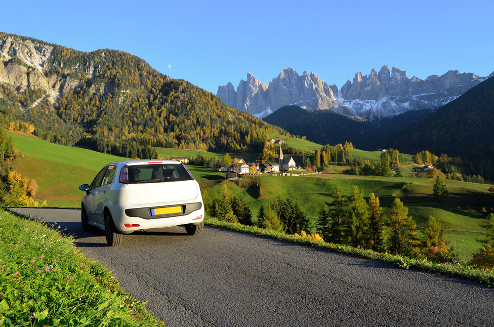 car driving through the Dolomites in Italy
