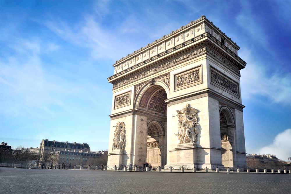 View of the Arc de Triomphe set against a blue sky, Paris in a Day
