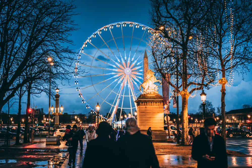 ride the ferris wheel during christmas in paris