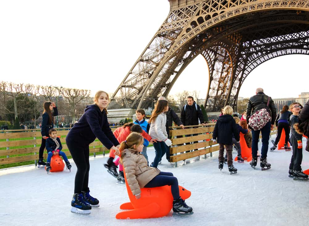 ice skating at the eiffel tower is a great way to spend christmas in paris