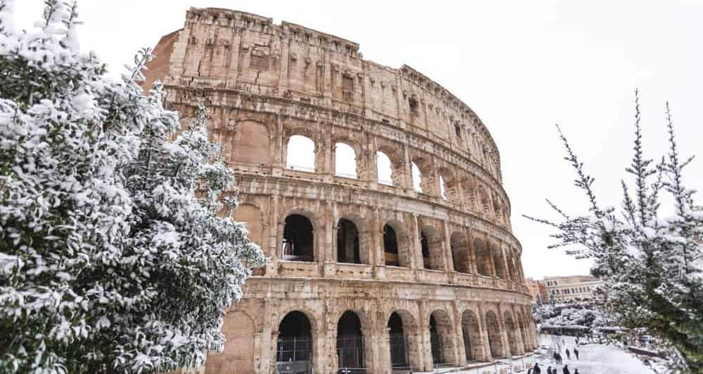 The Coliseum covered in snow during winter in Rome