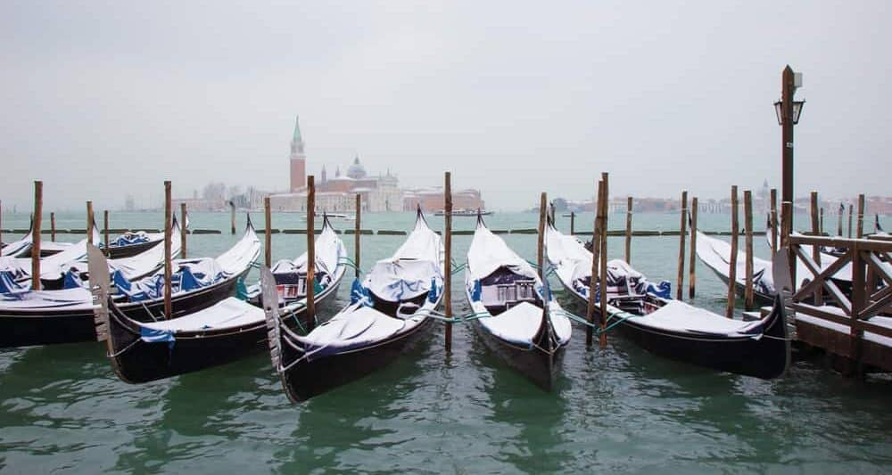 Enjoy a Gondola Ride with a blanket while visiting Venice in winter