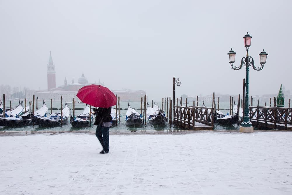 Snow on the Gondolas in Venice in winter
