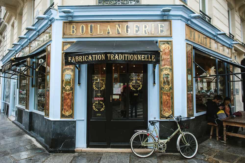 exterior of blue Parisian cafe with bike
