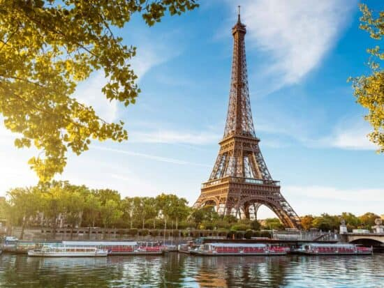 View of the Eiffel Tower with the Seine and riverboats
