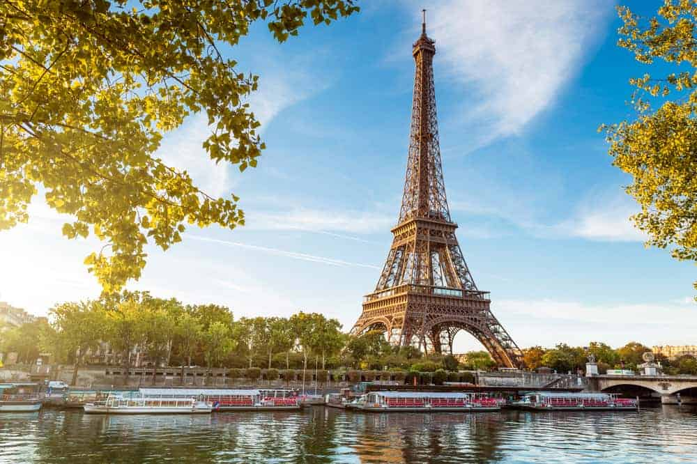 View of the Eiffel Tower with the Seine and riverboats, Paris in a Day