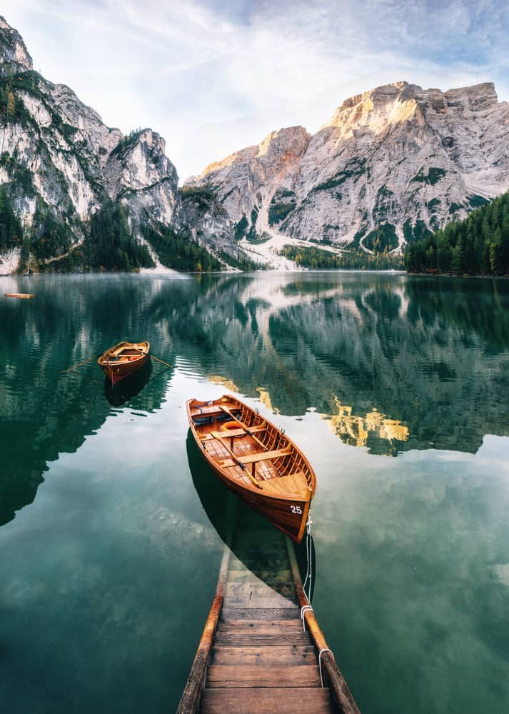Boats on a blue lake in the Dolomites in Italy