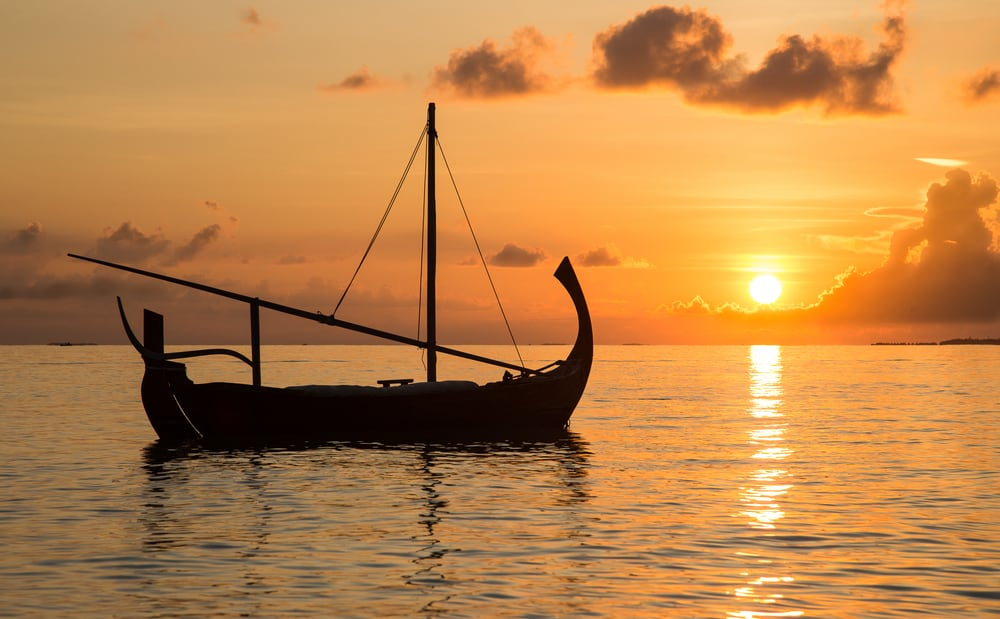 Photo of Sailboat at Sunset in the Maldives