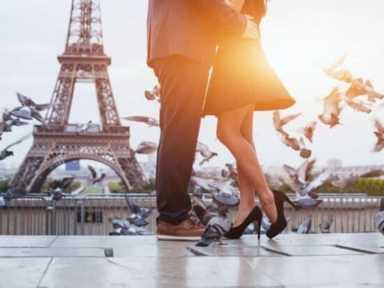 couple at sunrise on their paris honeymoon
