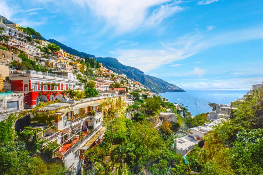 The colorful houses and mountainside of Praiano, an amazing choice of where to stay on the Amalfi Coast