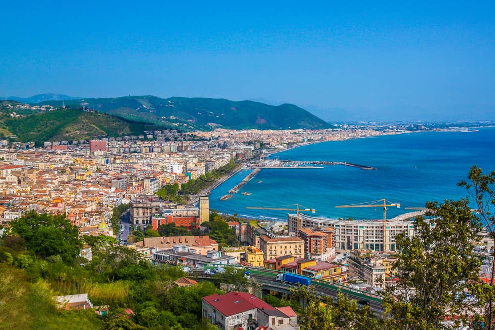 The lovely town and blue waters of Salerno, a great choice of where to stay on the Amalfi Coast