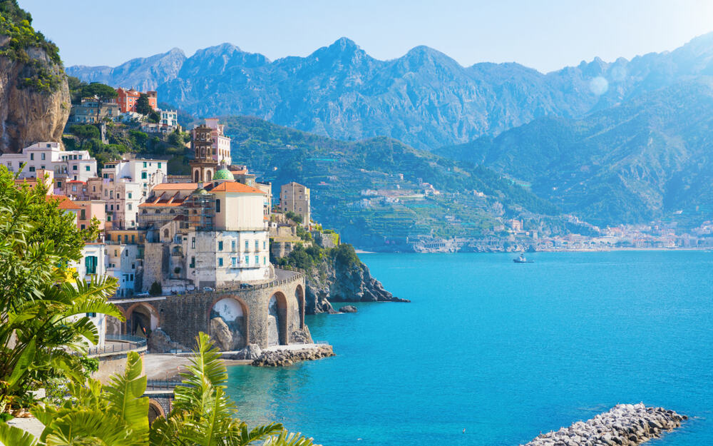 Striking waters and buildings on the Amalfi Coast. Any of the gorgeous towns make a great choice of where to stay on the Amalfi Coast