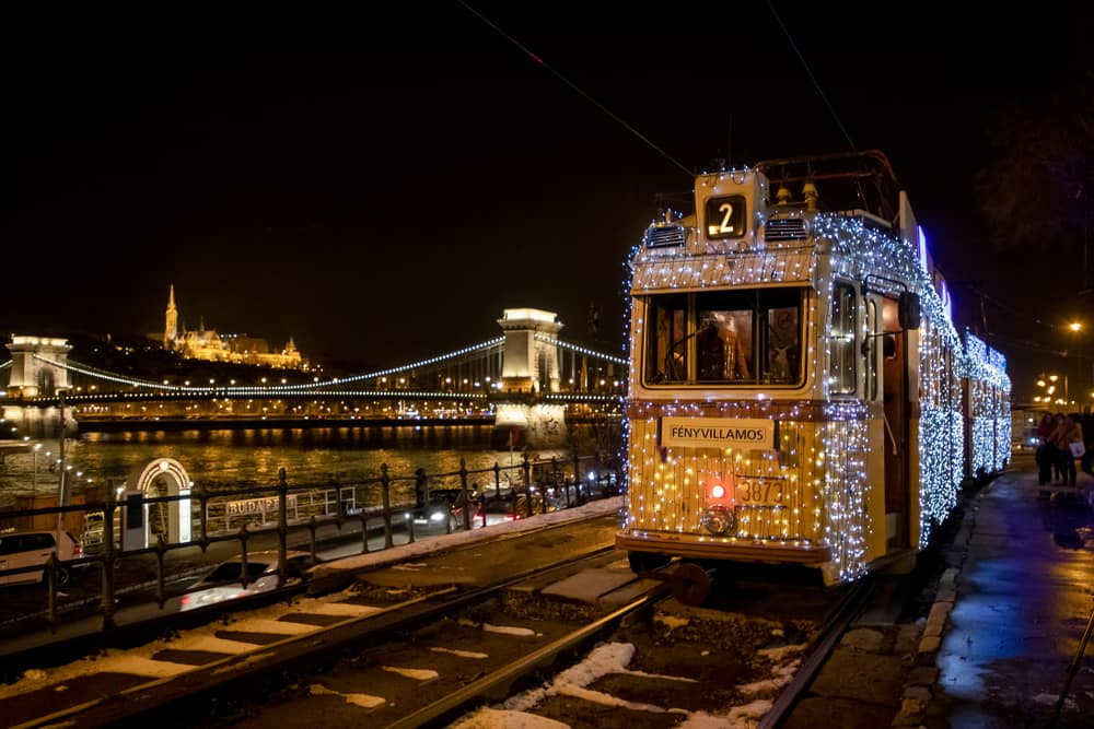 Thousands of fairy lights cover the winter tram during Budapest in winter