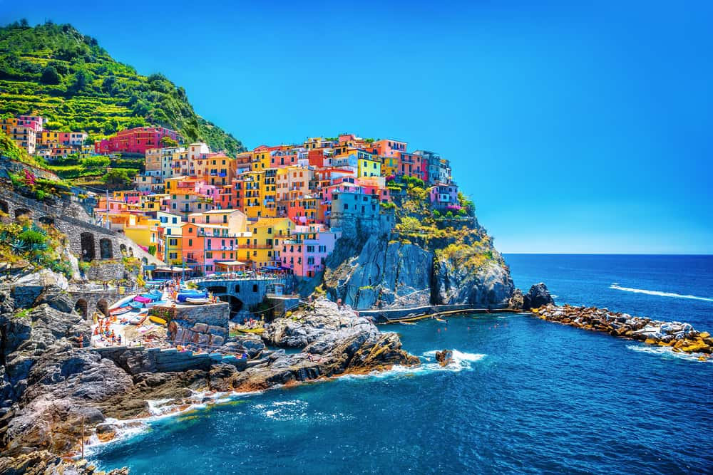 Photo of Cinque Terre village with beaches next to the sea.