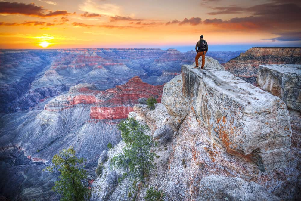 a hiker looks at the views on one of the Grand Canyon hikes