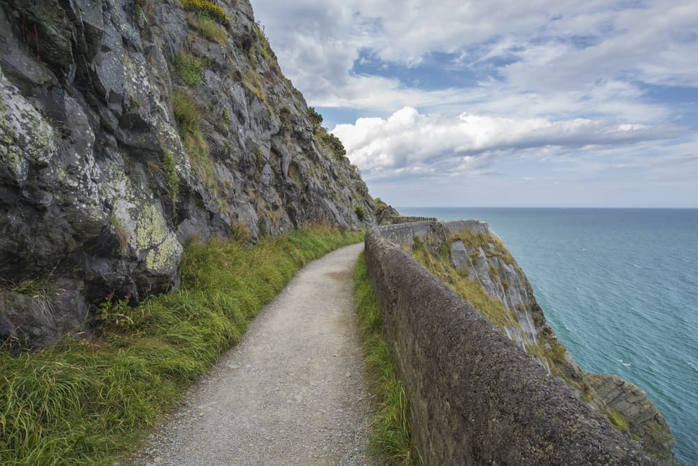 one of the unique hikes in Ireland Bray to Greystones has a path carved into the cliffside along the water following the same route as the train