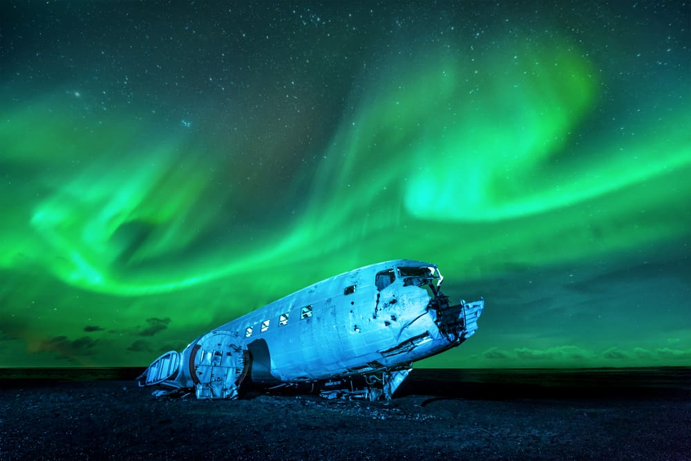 Northern Lights over Solheimasandur Plane Wreck in Iceland in January
