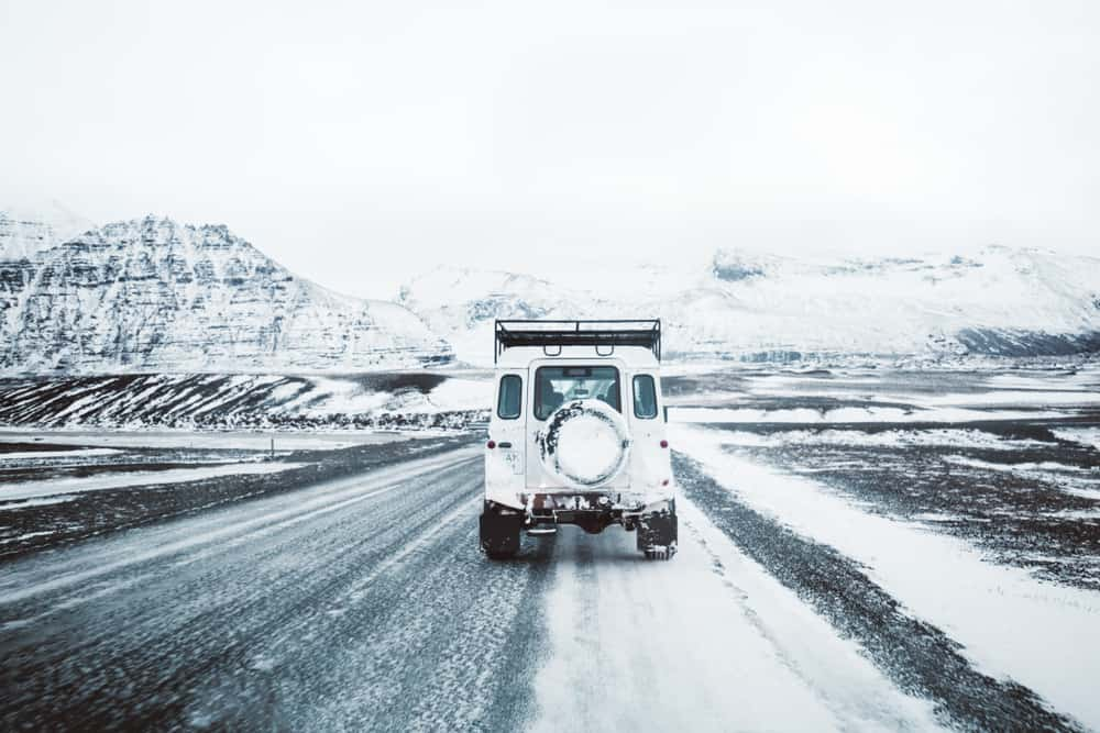 car driving winter roads in Iceland in January