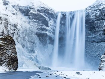Skogafoss Waterfall with snow in Iceland in January