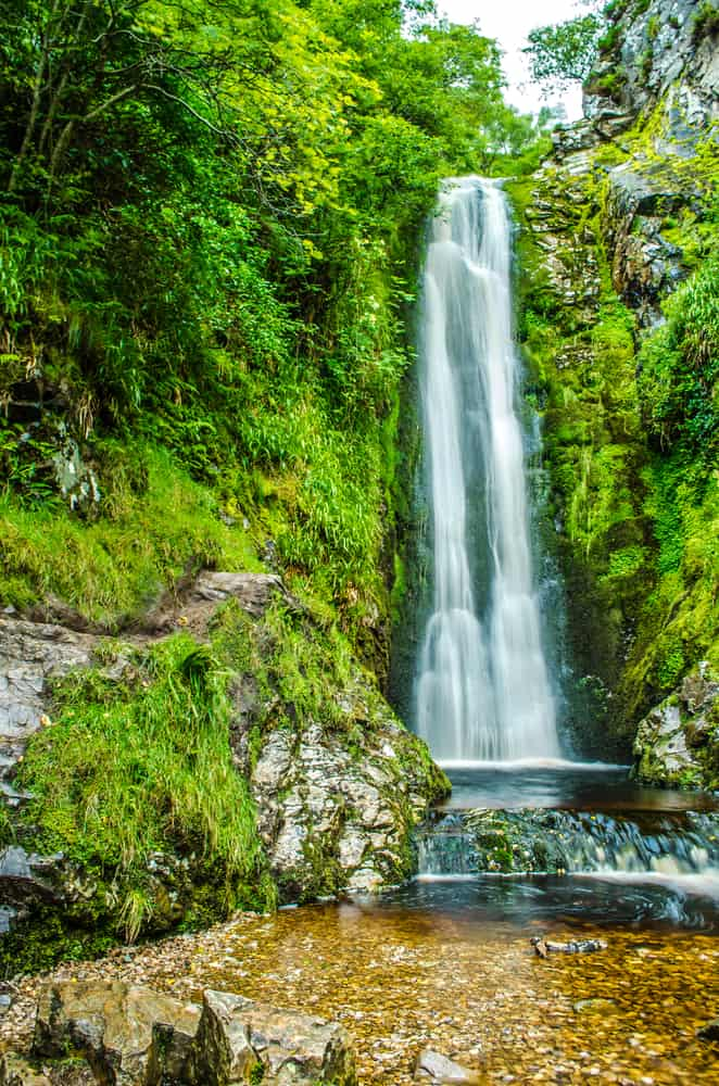 Waterfall in Ireland surrounded by greenery