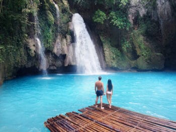 Photo of couple at waterfall, just like you on your Hawaii Honeymoon