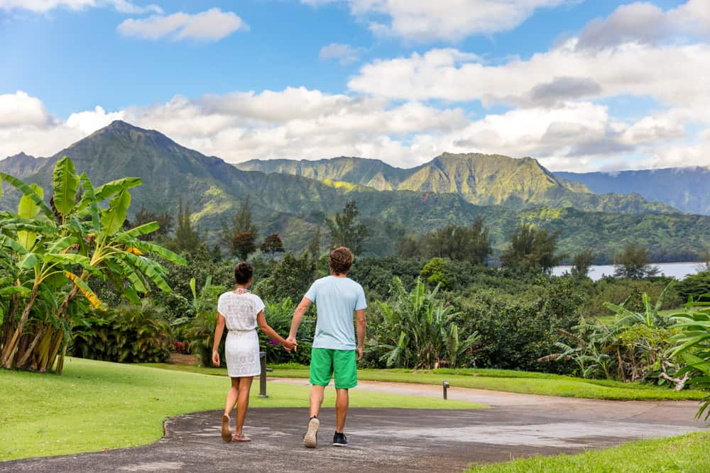 Photo of a couple who could be experiencing a Hawaii honeymoon at Hanalei Bay
