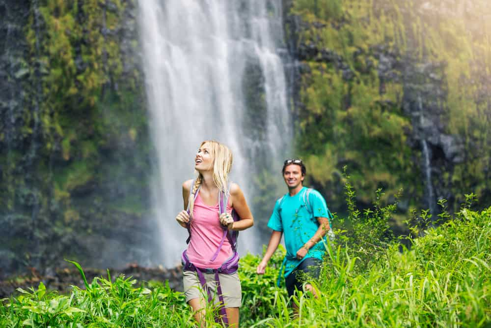 Photo of couple doing a waterfall hike together