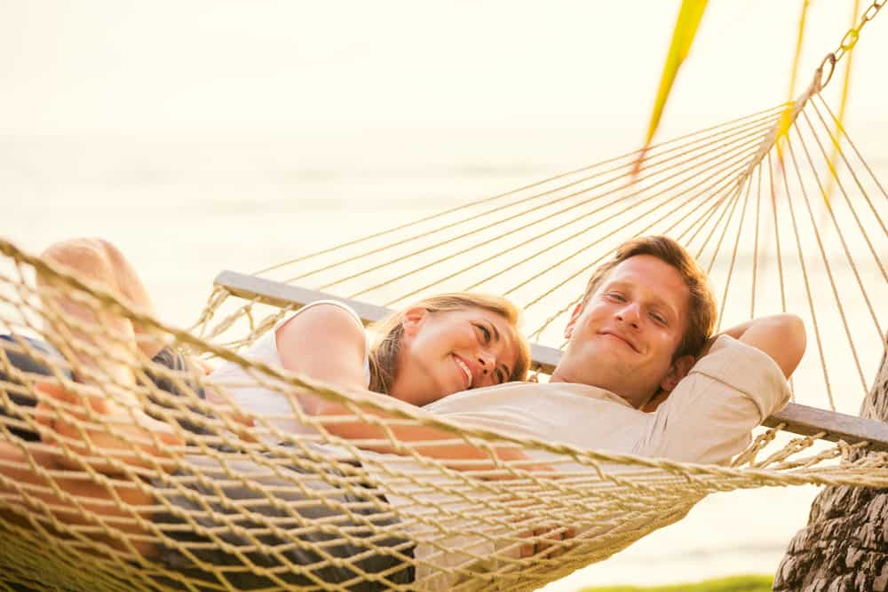 Photo of couple in hammock who may be enjoying a honeymoon in Hawaii.