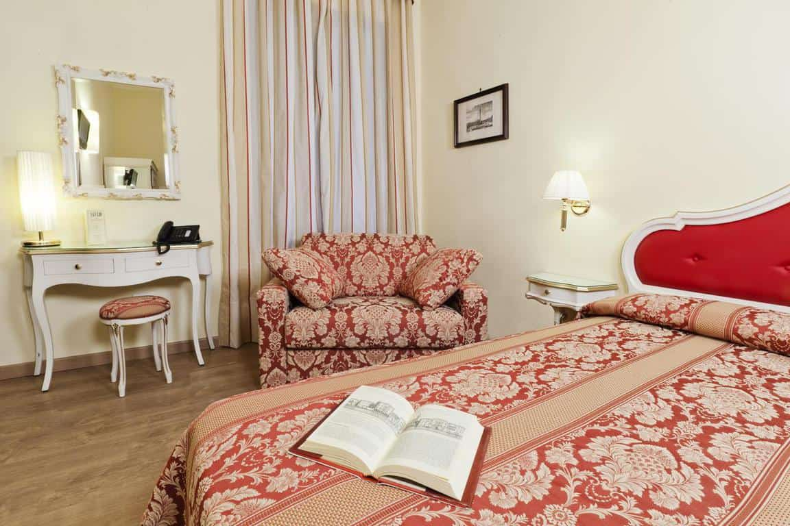 A charming room in San Lio Tourist Home, a great choice of where to stay in Venice
