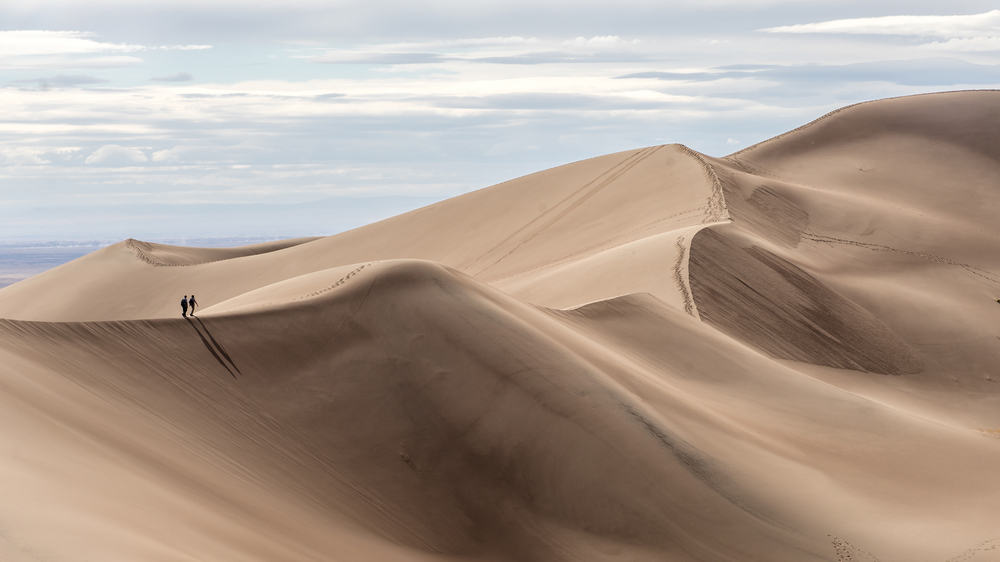 hike the sand dunes at Great Sand Dunes National Park on your Colorado road trip
