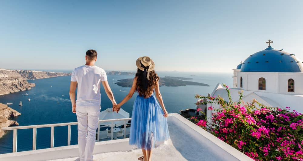Photo of a couple in Greece, like you and your lover soon will be on your Greece honeymoon.
