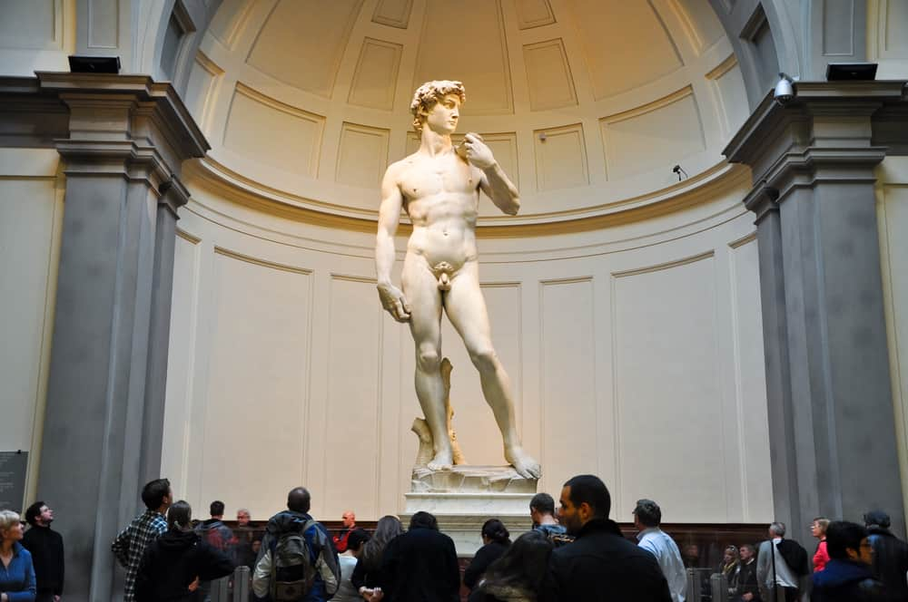 group of people viewing statue of david